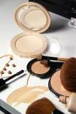 Make-up, foundation and brushes Stock Photos