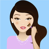 Make Up girl. A cute girl applying blush Stock Photography