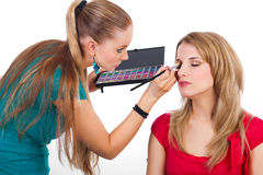 Make-up girl during her job Stock Image