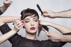 Make Up Girl. Girl model gets applied makeup Royalty Free Stock Images