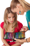 Make-up girl showing range of collors Stock Photos