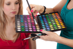 Make-up girl showing range of collors Stock Photography