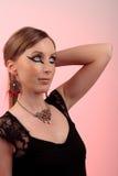 Make-up girl vintage necklace pink background Royalty Free Stock Images