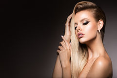 Make up. Glamour portrait of beautiful woman model with fresh makeup and romantic hairstyle. Glamour portrait of beautiful girl model with makeup and romantic Stock Images