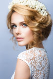 Make up. Glamour portrait of beautiful woman model with fresh makeup and romantic wavy hairstyle. Stock Photography