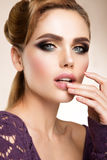 Make up. Glamour portrait of beautiful woman model with fresh makeup and romantic wavy hairstyle. Royalty Free Stock Image