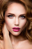 Make up. Glamour portrait of beautiful woman model with fresh makeup and romantic wavy hairstyle. Stock Images