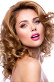 Make up. Glamour portrait of beautiful woman model with fresh makeup and romantic wavy hairstyle. Stock Photos