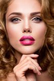 Make up. Glamour portrait of beautiful woman model with fresh makeup and romantic wavy hairstyle. Stock Photo