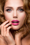 Make up. Glamour portrait of beautiful woman model with fresh makeup and romantic wavy hairstyle. Royalty Free Stock Images