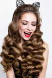 Make up. Glamour portrait of beautiful woman model with fresh makeup and romantic wavy hairstyle. Stock Image