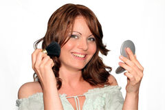 Make up, gray dress series. Girl is using her make up collection in several phases, powder or blush brush Stock Photos