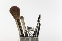 Make-up and grooming tools and brushes. Close-up of some feminine make-up and grooming tools and brushes Royalty Free Stock Images