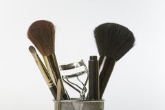 Make-up and grooming tools and brushes. Close-up of some feminine make-up and grooming tools and brushes Stock Photography