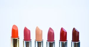 Daily make up. High quality lipstick. Cosmetics artistry. Lipstick for professional make up. Pick color which suits you. Compare makeup products. Lip care royalty free stock photography