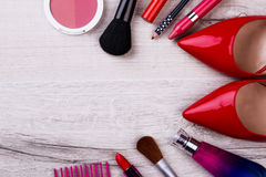 Make-up items and footwear. Cosmetic products on wooden surface. Shine like a star. Beauty is art stock images