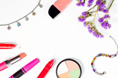 Make up items and jewellery on white background, text space. Royalty Free Stock Photo
