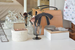 Make up items and leather bag on dressing table Stock Images