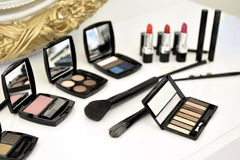 Make up Kit. A colorful make up kit on table indoor stock photos