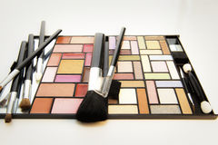 Make-up kit and brushes. Various make-up brushes with colorful make-up kit Royalty Free Stock Photography
