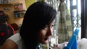 Make up Lifestyle Thai woman use Lipstick, lip gloss stock footage