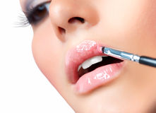 Make-up. Lipgloss Applying Stock Photos