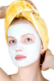 Make-up mask. On feminine person Stock Photography
