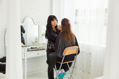 Make-up master doing visage indoors Royalty Free Stock Photo