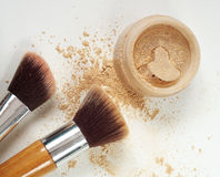 Make up mineral powder in plastic jar with cosmetic brushes Royalty Free Stock Image