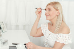 Make-up before the mirror at home Royalty Free Stock Photography