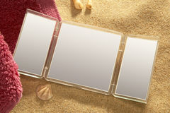 Make up mirror and towel in the beach Stock Photo