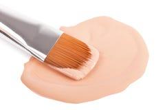 Make-up neilon brush with foundation Royalty Free Stock Image