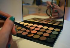 Make up - eyeshadow palette and brush stock photography