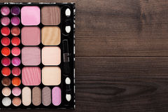 Make-up palette on brown wooden background Royalty Free Stock Images