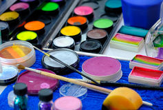 Make-up palettes, brushes and other tools. Close up Stock Photo