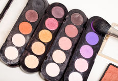 Make-up palettes. Different used make-up palettes and a brush Stock Images