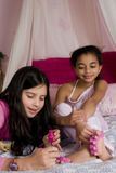 Make-up Party. Adorable girls doing make up at a slumber party Stock Photos