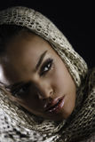 Make-up. Portrait of beautiful fashion girl with make-up and scarf Stock Photos
