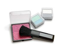 Make-up powder and brush Stock Images