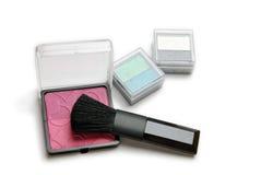 Make-up powder and brush Stock Images