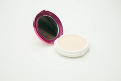 Make up powder cream color with powder puff Stock Images