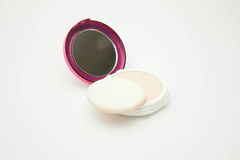 Make up powder cream color with powder puff on white Royalty Free Stock Images