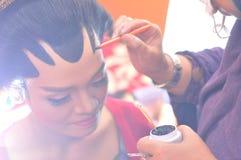 Make up process at javanese wedding ceremony royalty free stock photo