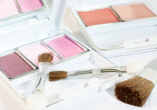 Make Up Product - Box. Make up product with eyes shadow, brushes and blush on in white cosmetic box with mirror. Eyes shadow palette are pink and purple royalty free stock photography