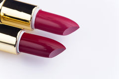 Make-up products. Red lipstick on white background Royalty Free Stock Photos