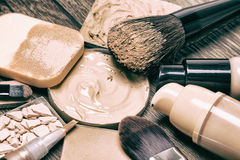 Make up products for flawless complexion. Foundation, concealer, powder with cosmetic sponge and professional makeup brushes. Selective focus, toned image Stock Image