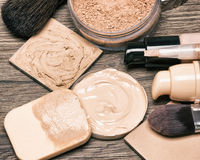Make up products for flawless complexion. Foundation, concealer, powder with cosmetic sponge and professional makeup brushes. Selective focus, toned image Stock Photo