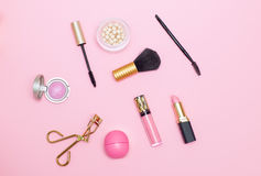 Make up products pink background. Flat lay Royalty Free Stock Image