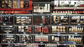 Make-up products. Shop shelves Stock Photos