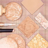 Make up products to even skin tone and complexion. Makeup products to even skin tone and complexion: concealer stick, highlighter, foundation, compact and Stock Images